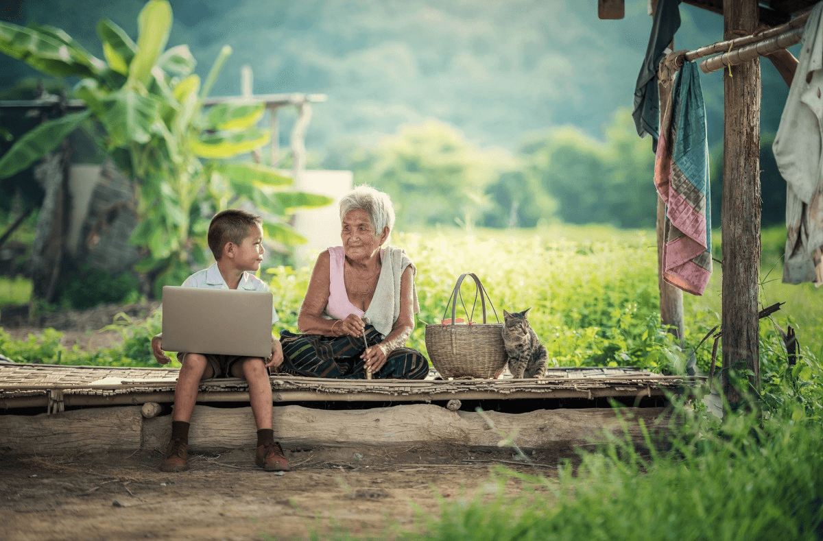 child with grandmother on a computer Myanmar
